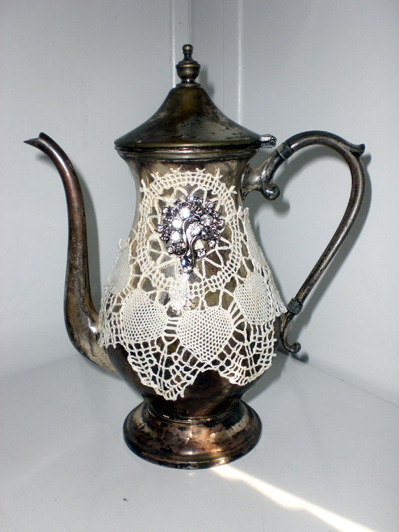 Altered silver plated teapot