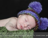 Funny square hat of a melange yarn with 2 pompoms. Sizes 0 - 12 month.  Lavender and herbs