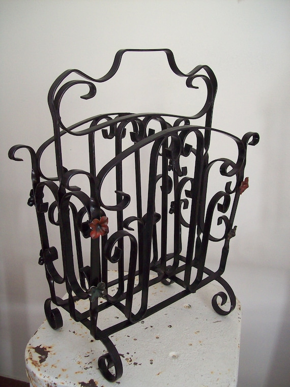 Antique iron magazine rack adorned with flowers 1930s must see