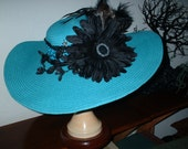 The Turquoise and Black Giant Daisy Hat