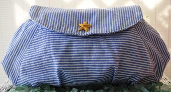 Blue and white striped seersucker clutch