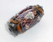 Lampwork focal bead, copper mesh on black base