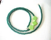 Green necklace with glass beads and green jasper rombus gems