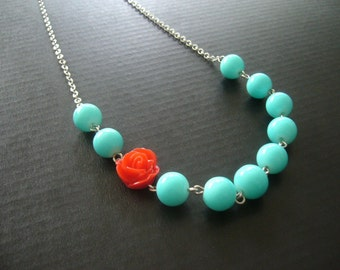 Aqua and a red flower necklace