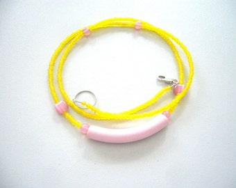 Yellow and pink necklace with glass beads, quartz and ceramic