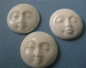 Three hand carved faces