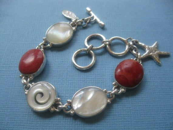 Sterling silver, apple coral, mother of pearl, with a wish star fish wish charm Bracelet .carved mother of pearl  with the goddess swirl