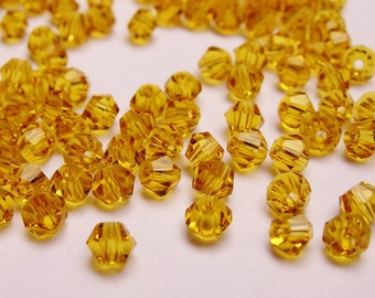 Crystal 3mm Bicone 100 pcs AA quality --yellow topaz