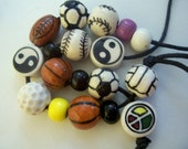 18 Ceramic Painted Beads - Sports and Symbols - Destash
