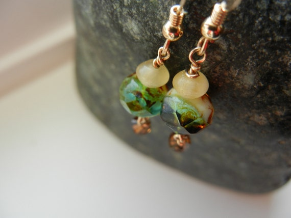 Pretty dangles in butter amber rondelle with czech faceted greens and rusty browns with teeny green seed bead and topaz swarovski bicone