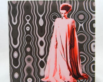 The bride of Frankenstein on wood panel