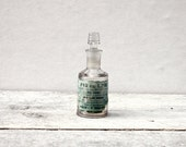 Antique Medicine Bottle: A small French glass bottle from 1900