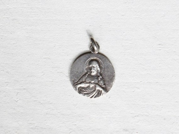 Antique French medal, A sterling silver pendant Jesus Christ and Virgin Mary