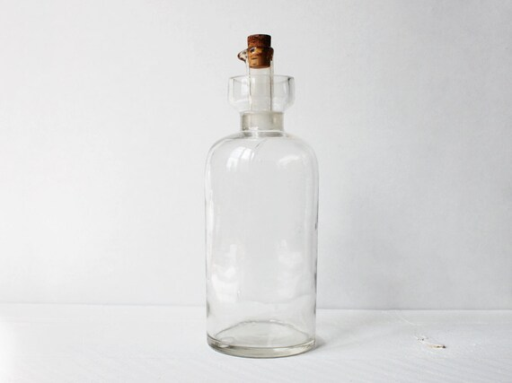 A vintage apothecary bottle, A mineral oil bottle