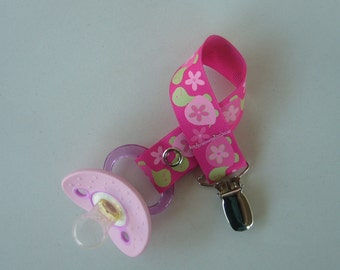 Pink and green turtles pacifier clip