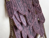 Screenprinted feathers on violet leather bodyjewellery chain harness