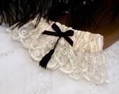 Satin Ivory Wedding Garter with Black Bow and Tassel