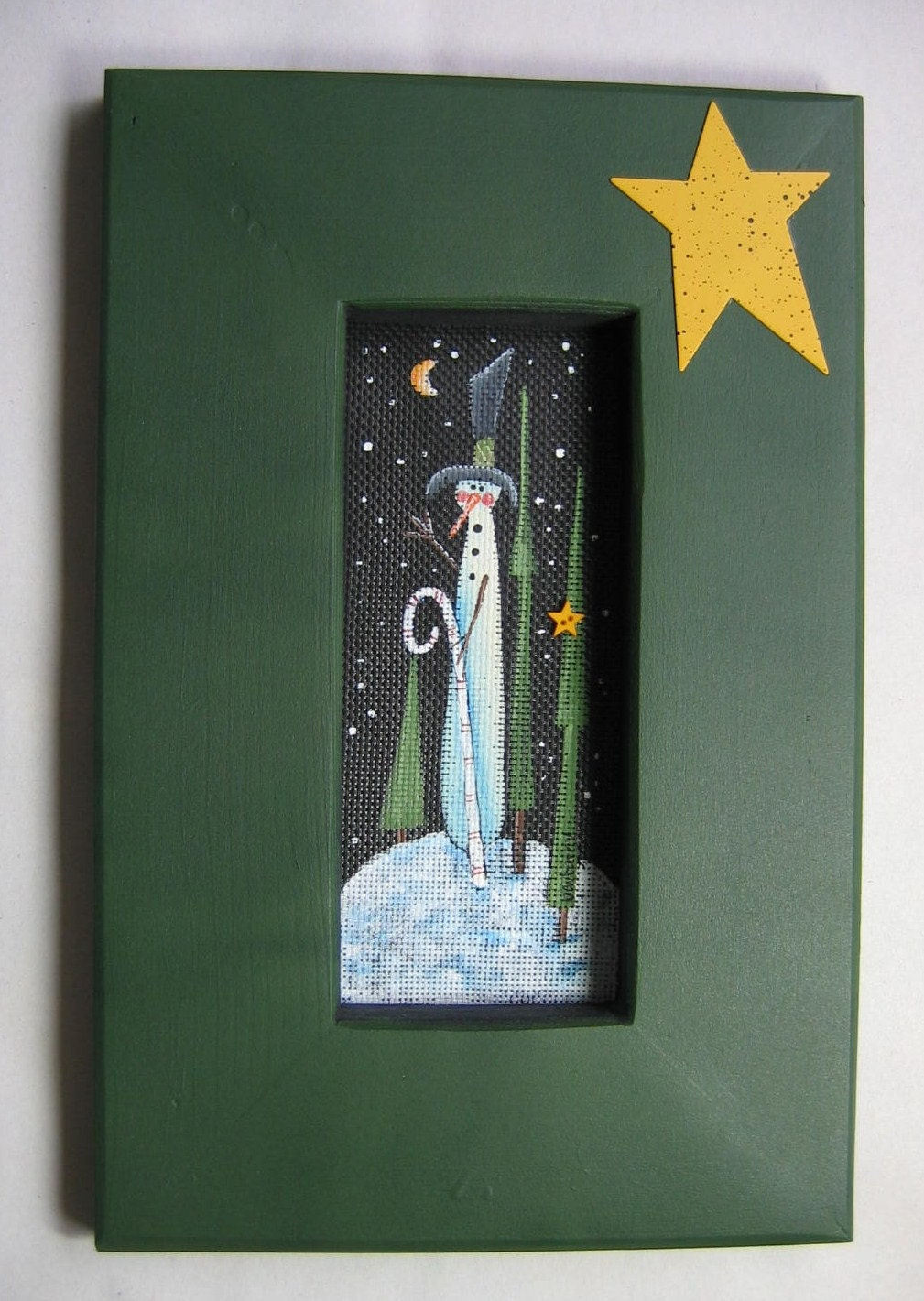 tole painted snowman with candy cane framed in green