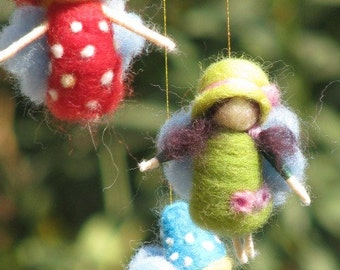 A rainbow fairies mobile, needle felted