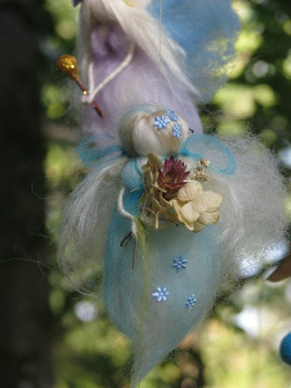 A charming needle felted mobile with angels