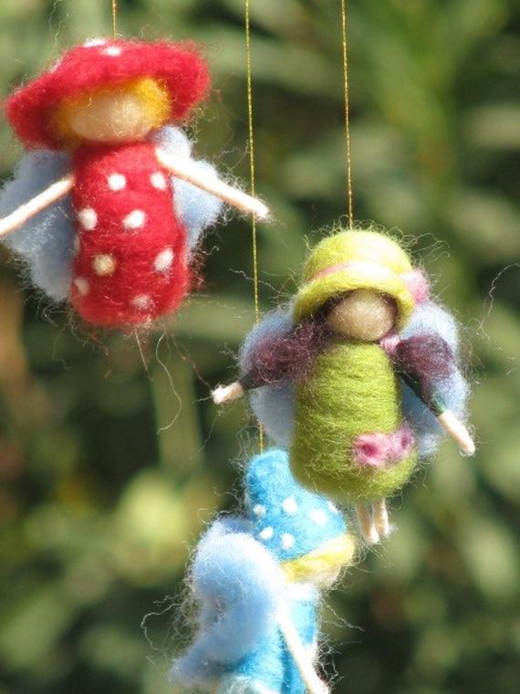 A rainbow fairies mobile, needle felted