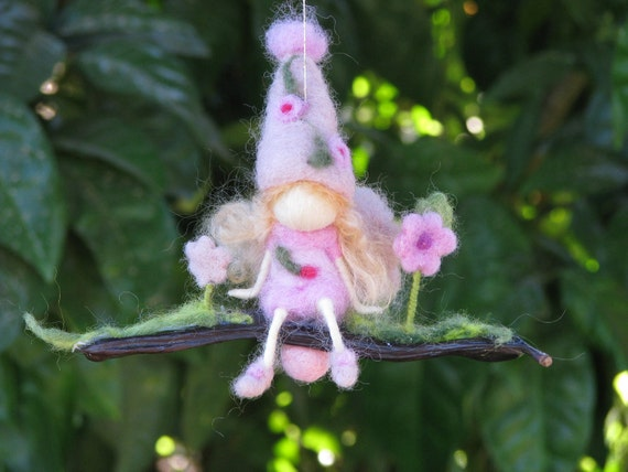 Needle felted little flower fairy on a seed - waldorf inspired