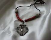 A Necklace made of coral beads, silver beads and silver pendant