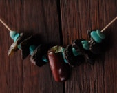 WATERFALL necklace with black basalt lava rock, dark red coral, and turquoise stone on Sterling Silver chain
