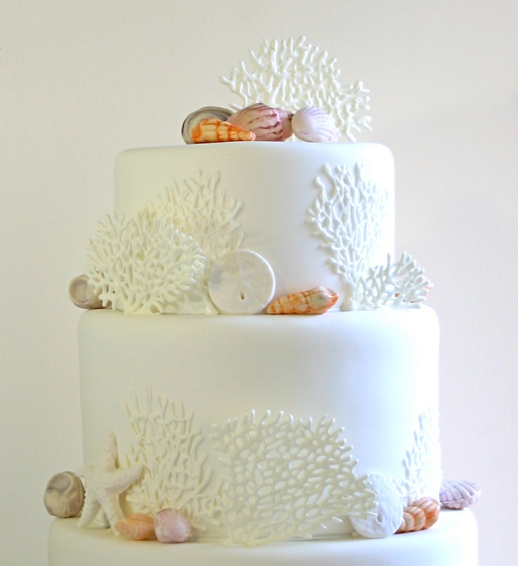 Pretty white beach wedding cake with edible coral