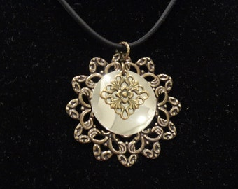 Surprise pendant in antique gold and shiny silver (Style #1345B)