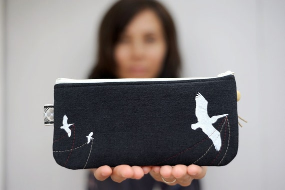 eco friendly handprinted pelican pouch in upcycled black denim