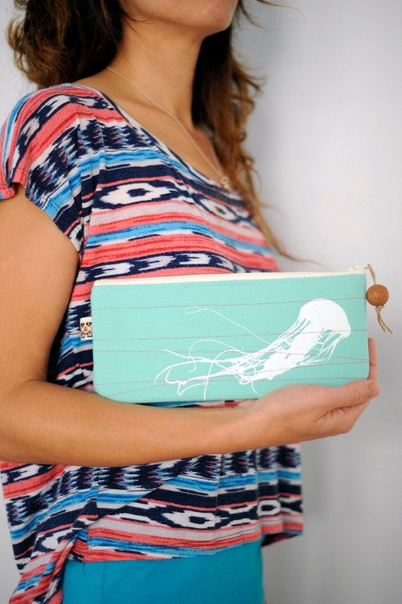 ecofriendly handprinted jellyfish clutch in upcycled mint