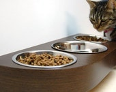 Wall mounted pet feeder for cats