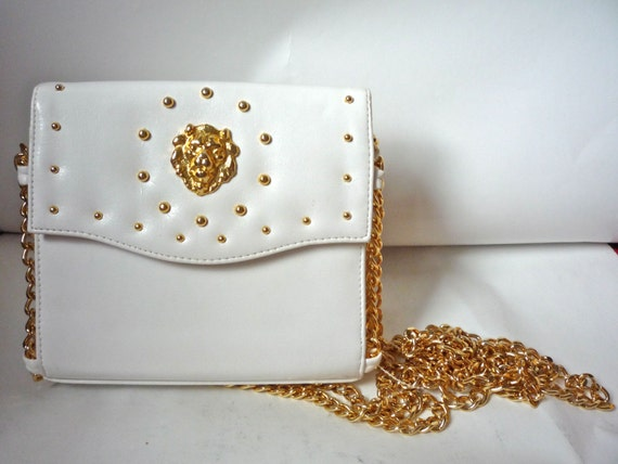 VINTAGE White purse with chain and lion detailing Very 80s