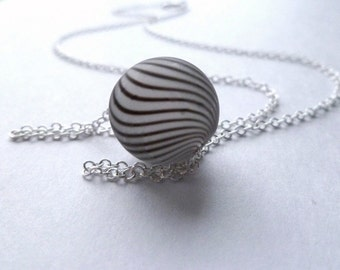 Zebra stripe necklace - simple hollow blown frost glass bead in matte black and white dizzy swirl design - delicate silver plated oval chain