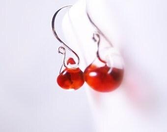Red hot earrings - small boro clear encased glass lampwork drops on .925 sterling silver ear hooks - Fire Starter