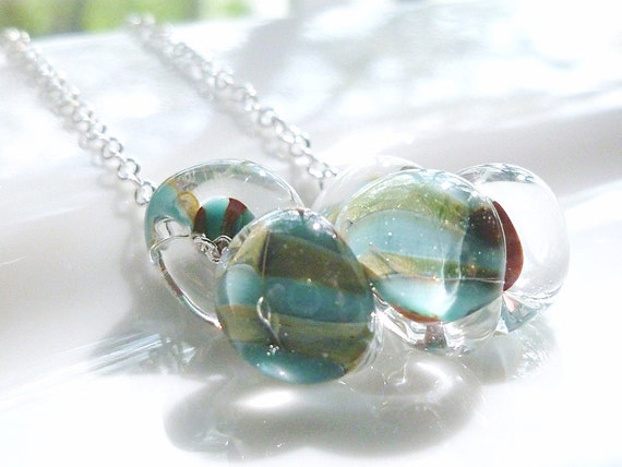 Blue lampwork necklace with swirls of sage and aqua in clear boro glass drops - teardrops nested on a delicate silver chain