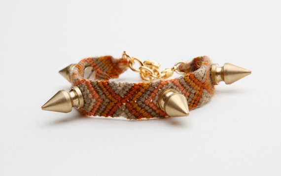 friendship bracelet with 4 small golden spikes