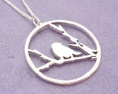 Bird on snowy branch Handmade Pendant on chain