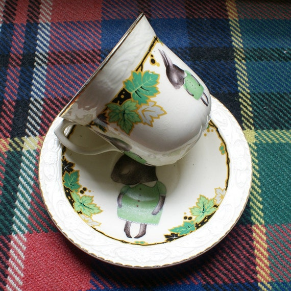 Illustrated Vintage Cup and Saucer Set With Shy Bunnies and Green Vine Leaves