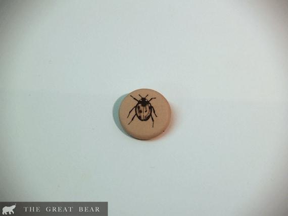 Ladybird fabric pin brooch.