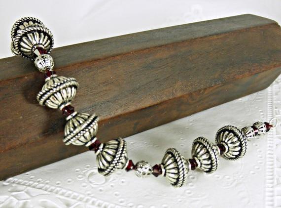 Antiqued Silver Plated Rondelle Bead & Red Swarovski Crystal Bracelet