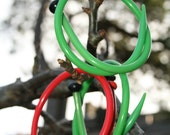Trio of vintage repurposed knitting needle bangles - green and red