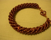 Beadwoven Bracelet with Bronze Metal Triangle Beads