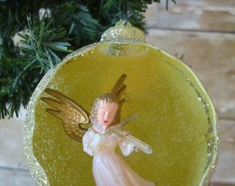 Vintage Angel Hard Plastic Christmas Ornament Yellow Round Playing Violin