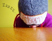 Charcoal Grey hand knitted and felted hat with Hibernate appliqued on front using recycled sweater for teens or adult.