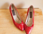 red heels // leather bowed // size 9n