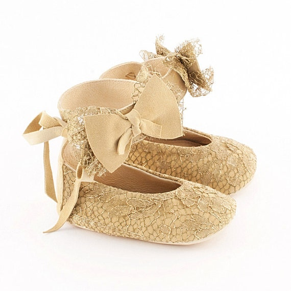Golden baby booties from lace covered suede leather