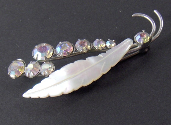 Vintage Rhinestone Mother of Pearl Pin Aurora Borealis Pin Brooch from Converged Commodities vestiesteam thebestvintage