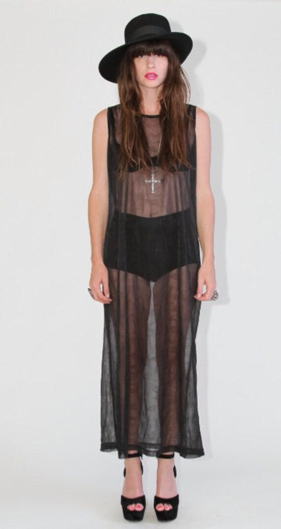 Black sheer maxi dress by DKNY